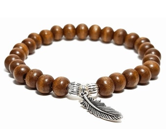 Ascension Bracelet: Wood Beads & 925 Silver Rondelle Beads with Antique Silver Feather Charm.