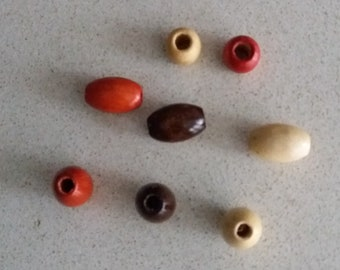 Oval wood beads. Lot of 8 units.