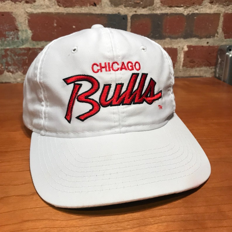 62064c91afee5 Vintage Chicago Bulls Script Snapback Hat Adjustable Twill NBA Basketball  90s Th... Vintage Chicago Bulls Script Snapback Hat Adjustable Twill NBA ...