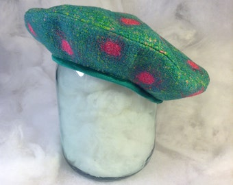 Original and stylish women's beret green with pink circles for the autumn-winter season.