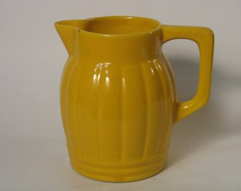 "Small yellow ""ORCHIES"" ceramic pitcher, vintage"