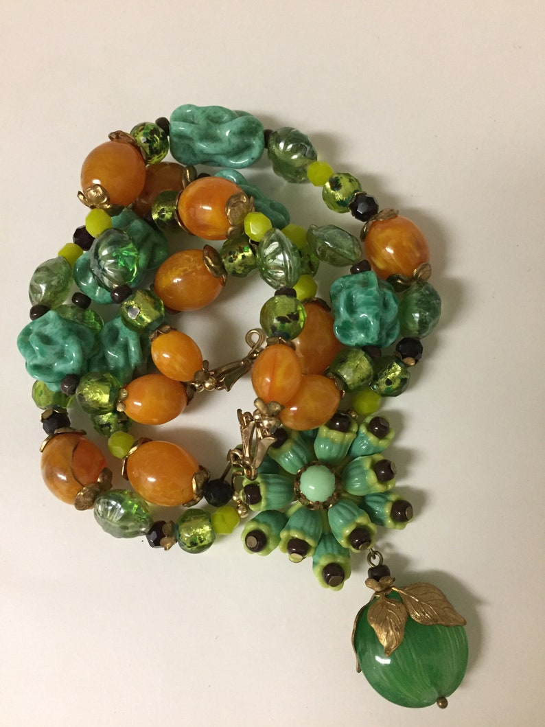 Vintage celluloid flower cluster with glass  burgundy seed beads necklace glass beads are green turquoise twists Japanese lamp work