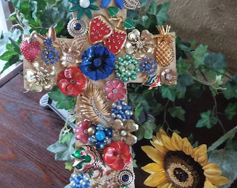 Reds, blues, greens, enamel flower, cross wall hanging