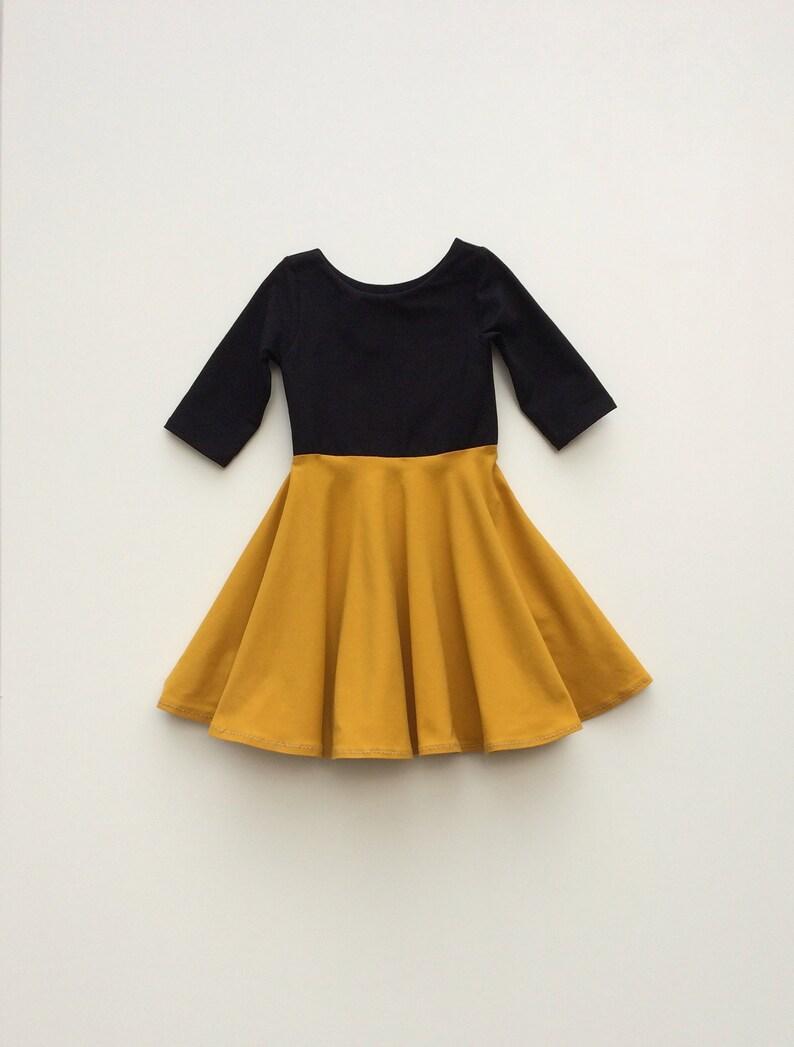665f99ca930 Twirl dress for girls. Black and mustard yellow toddler dress.