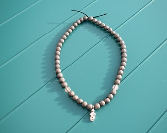 White glass venus necklace with silver beads