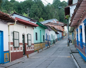 Colombia travel photography, street view wall art, guatape city of zocalos, colorful houses, cute small street