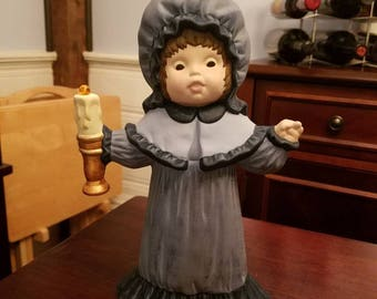 Victorian girl with candle
