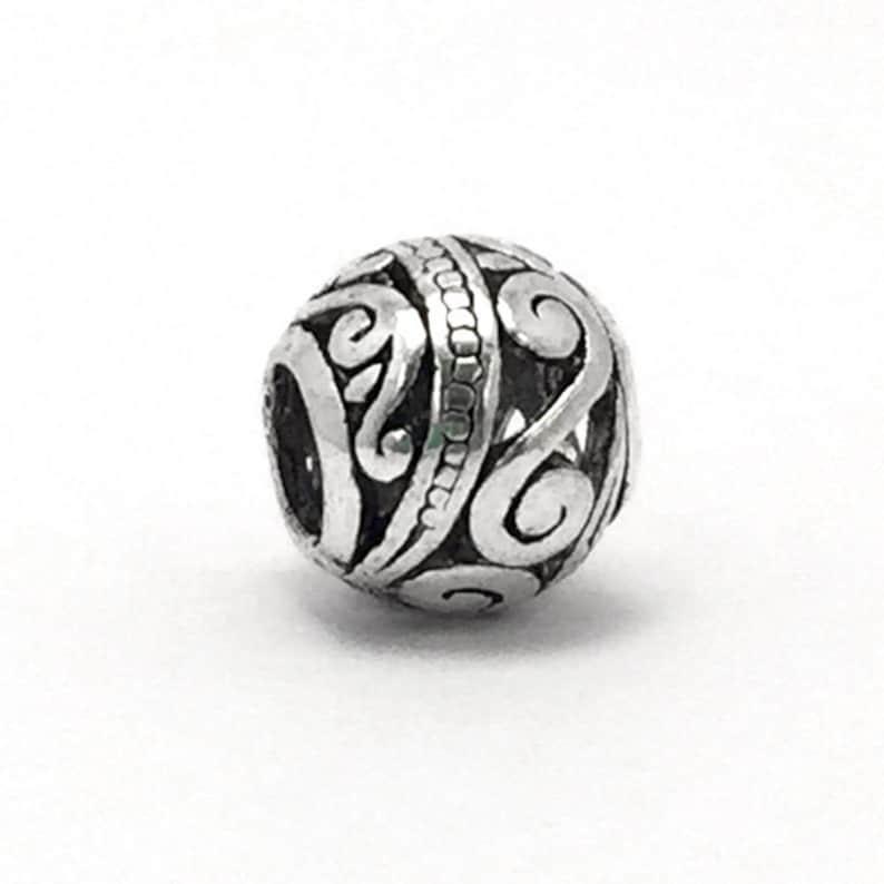 af260c906 Retro Tibetan Ribbon Swirl Charm fits Pandora Bracelets   Etsy