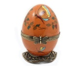 Orange Limoges handpaint French music egg. Bird collection. Craftsmanship. music box. Hand-painted porcelain chardonneret.