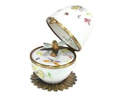 music box, decorative musical egg with bee. waltz flowers music. hand crafted Limoges France.