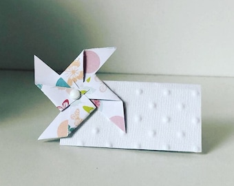 Brand place, name, grinder, butterfly, polka dots