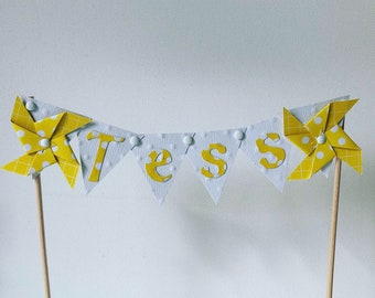 Cake topper flags and yellow pinwheels