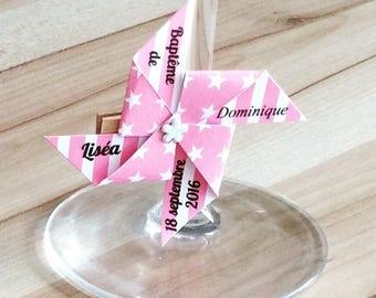 Marque place sur pince moulin rose