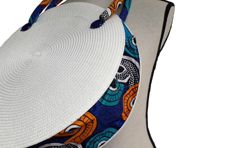 Bag white braided round basket Bottom fabric and stiff handles wax African.