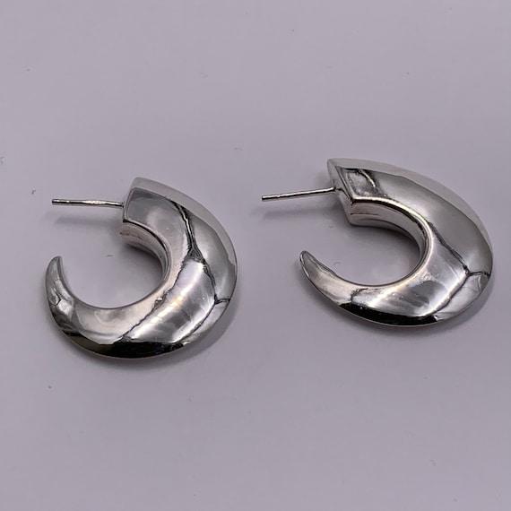 Sterling silver moon shaped post earrings.