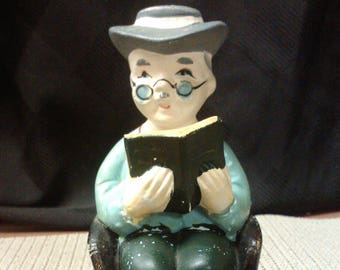 Man Reading Saving For My Old Age coin bank