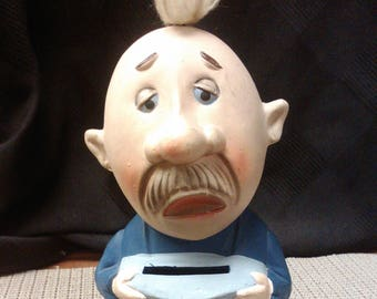 Man with one shoe coin bank