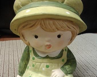 Girl in green coin bank