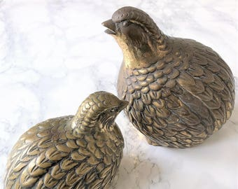 Group compound of two quails in golden brass
