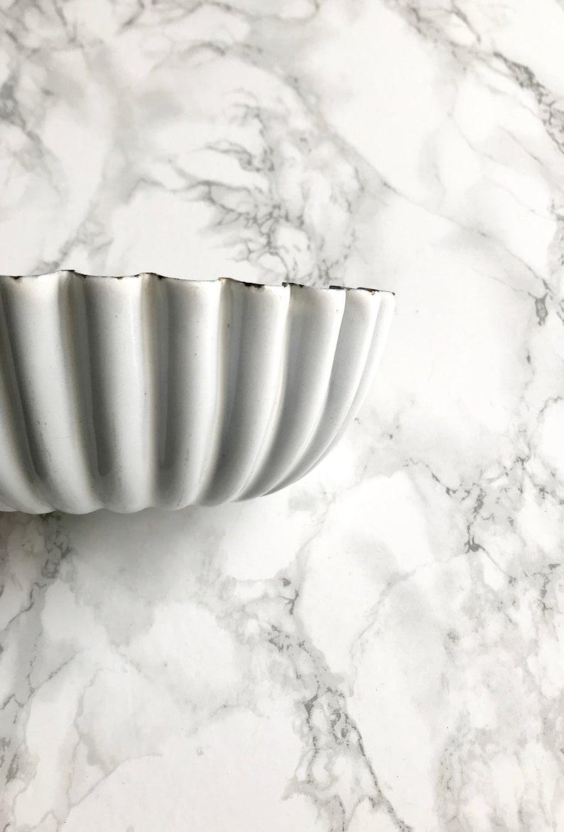 Old white enameled cake pan