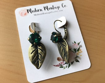 Antique Brass Leaf drop earrings with an 8mm Swarovski Emerald Crystal