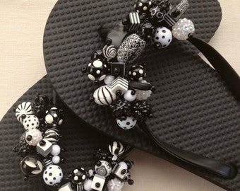 d8ab2f305a714 Black and White Mix of Beads on Black Flip Flops.