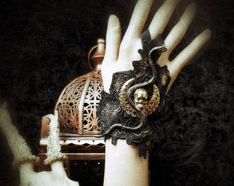 "Rare glove ""Touch of Snake"" in lace with 1 snake, skull and metal moon, in black gold/fingerless glove"