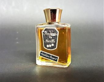 Vintage Perfume by Noville Parisian Accent Ninety Five Percent Full Bottle
