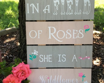 In a Field of Roses She is a Wildflower Nursery Wooden Sign