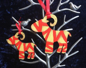 A pair of Yule goat decorations- mama and baby