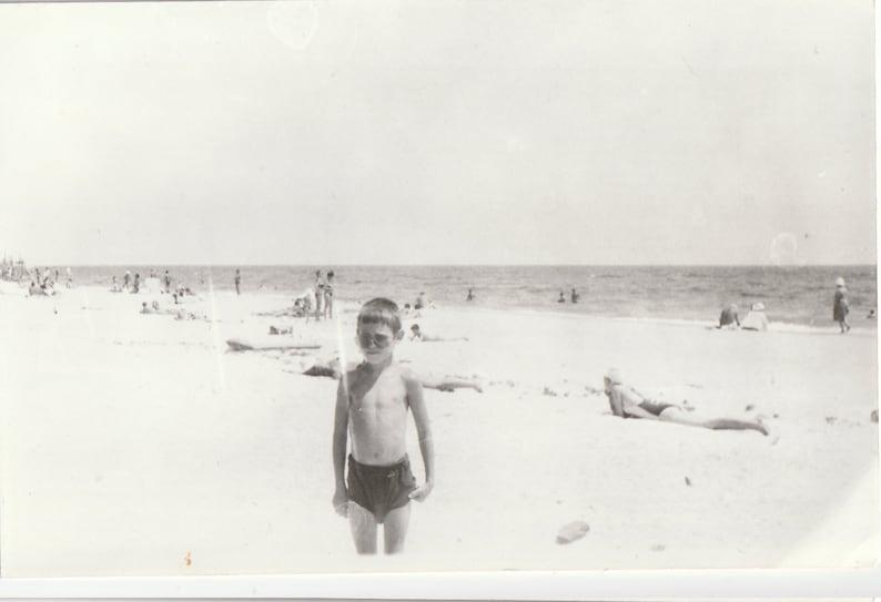 Handsome boy children on beach summer holidays snapshot vintage photo found photo