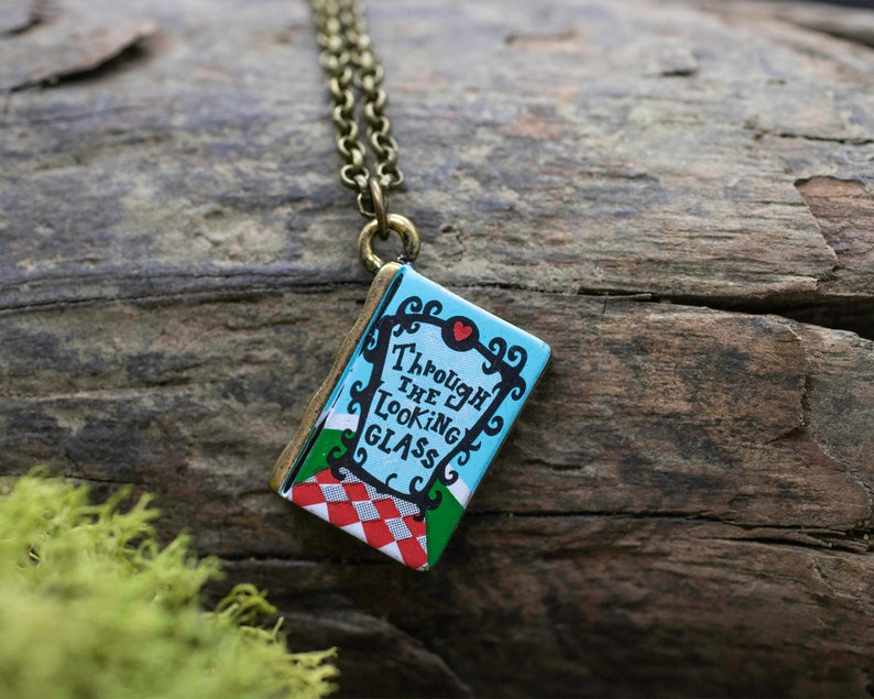 Clarion PAWS Fundraiser Brass Through the Looking Glass Book Charm Necklace
