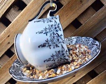 Black and White Cow Teacup Bird Feeder with Souvenir Cow Spoon from Holland, tea cup bird feeder, garden decor, bird feeder, cow decor