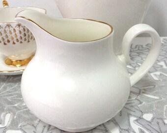Vintage and rare Royal Kent bone china creamer, warm white with gild detailing, Straffordshire