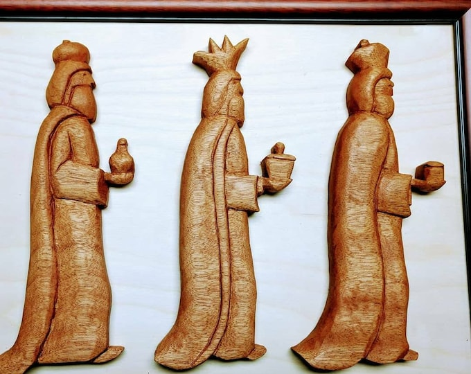 The Three Wisemen carved in Mahogany and framed.