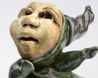 mossy green ceramic figure with horns