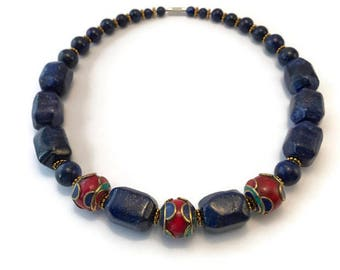 Lapis Lazuli chain with large handmade Tibetan beads strung on a stainless steel wire.
