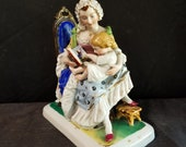 Old Paris Porcelain Figural Inkwell Mother Reading to Child with Pounce Pot mid 19th century