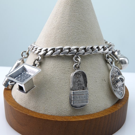 "7"" 1950's Rosi Mexican Silver Charm Bracelet."