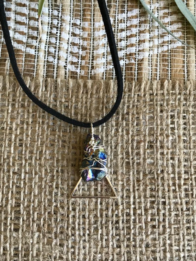 handmade.raw aurora borealis stone. gemstone boho rave jewelry Rainbow hematite triangle necklace.Rough crystal wrapped in silver wire