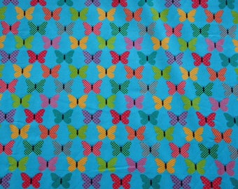 Multicolored butterflies on blue background