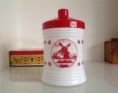 Retro storage jar white glass with a red lid Vintage Cigar jar