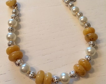 Pearl bracelet and yellow stones