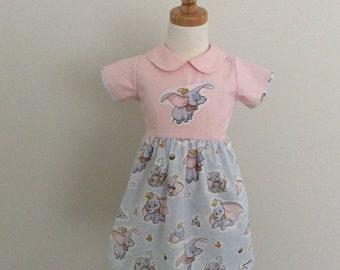 Boutique Ollie Girl Dumbo the Flying Elephant Peasant dress Girls