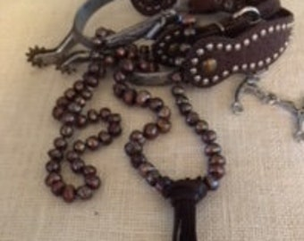 Hand knotted freshwater pearl with leather fringe.