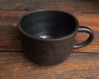 Ceramic Cup with faded black color glaze. handmade. pottery. mug. wheel thrown.