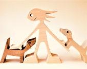 a woman two dachshunds ; sculpture bois