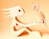 une femme un perroquet ; sculpture bois
