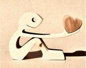 pour dire à quelqu'un que tu l'aimes bien mais que t'es trop fatigué pour lui dire debout ; sculpture bois chantourné