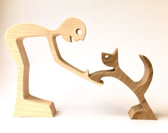 a man and his cat carving wood chanted